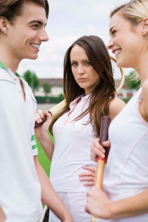 People flirting on tennis court